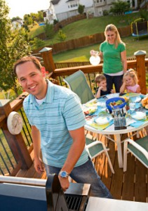 family grilling outside in summer