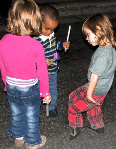 Three pre-schoolers experiment with street-dancing.